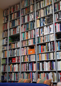 A full wall of floor to ceiling bookshelves.